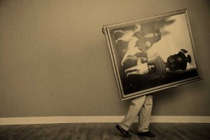 Man Carrying Large Painting --- Image by © Sean Justice/Corbis